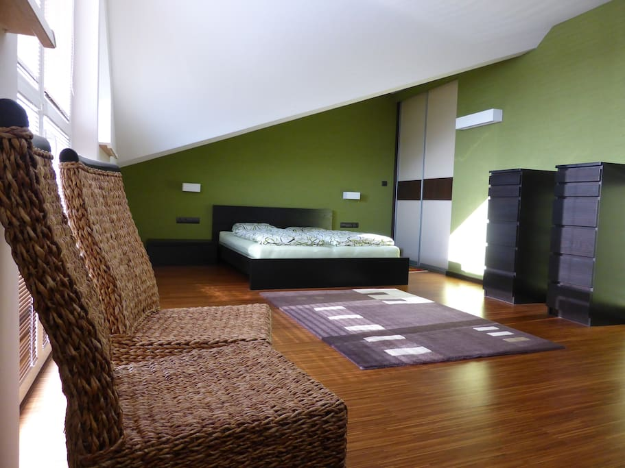 Green room with balcony and garden view