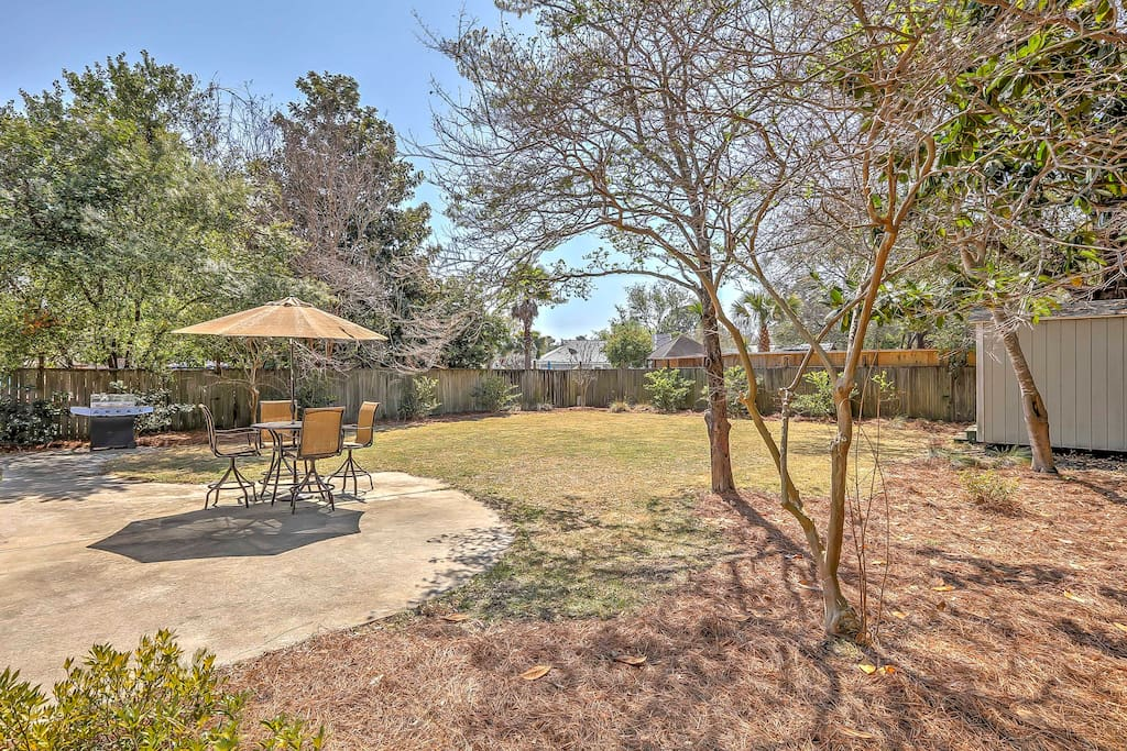 Soak up the sun in the spacious backyard, equipped with an outdoor grill and patio furniture.