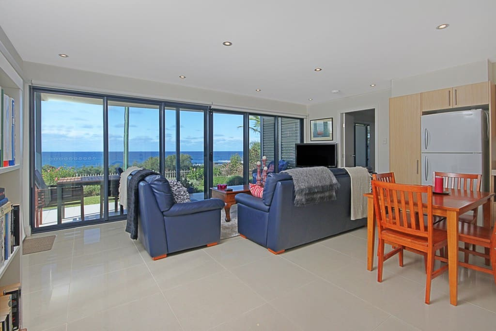 Spacious open plan living & kitchen with spectacular sea views