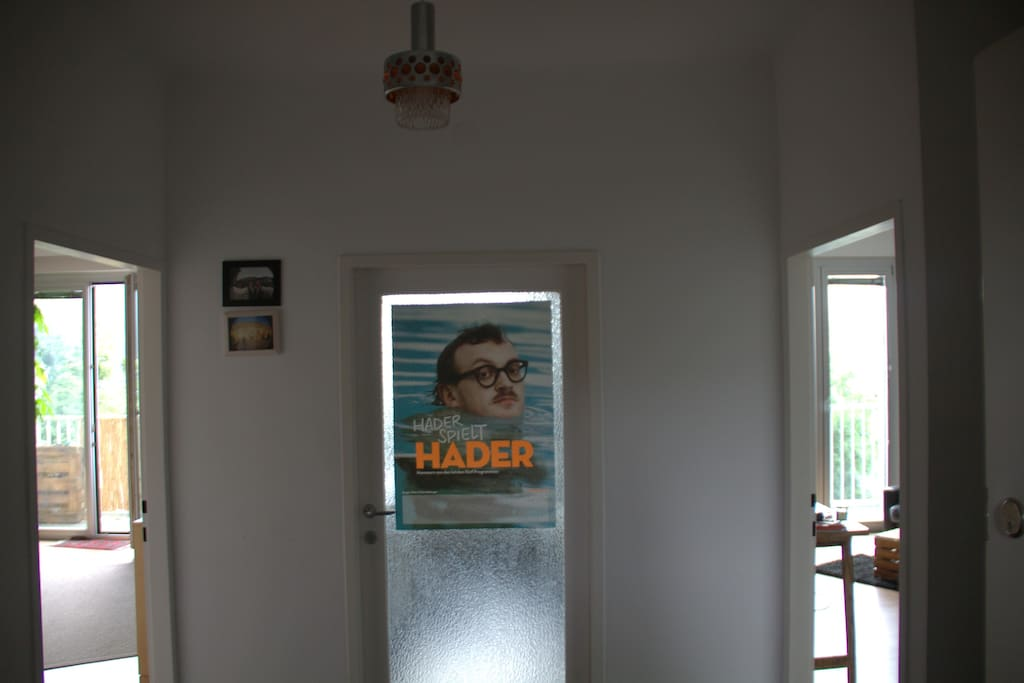 Mr. Hader will warmly welcome you when you enter the door. Leftjhandside the room with the reading corner. Righthandside the room with the stag antler