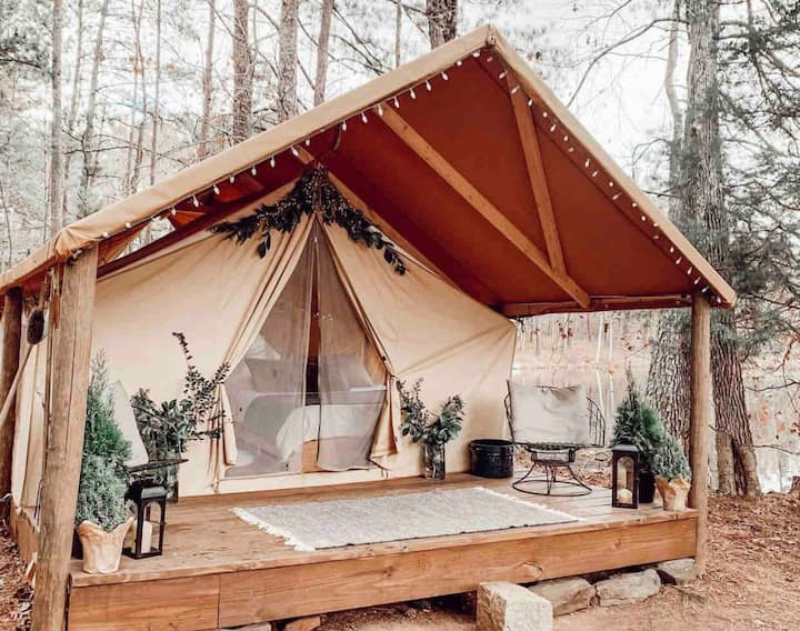 Heated luxury tent + campsite + lake front view