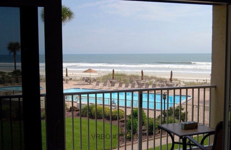 View of ocean and pool from the balcony off of den