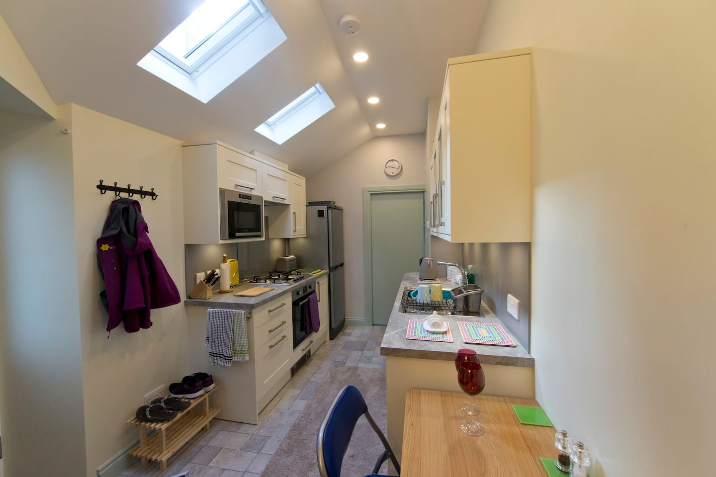 Fully furnished kitchen with dishwasher, fridge and cooker