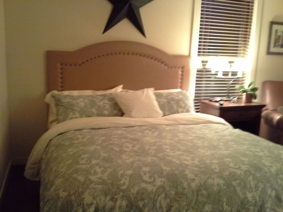 King size bed with down comforter.