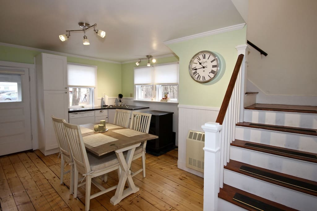 Eat-in kitchen and stairs to second floor