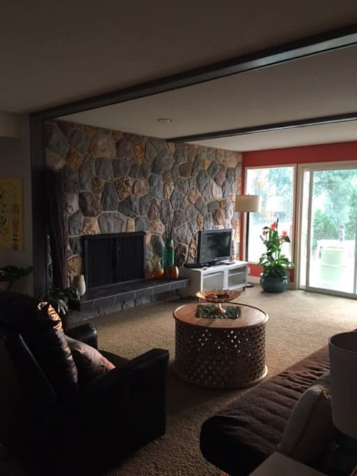 Living room with cable and TV. Beautiful views of mountains and outdoor living space.