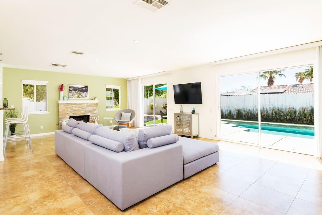 Living room overlooks the pool deck