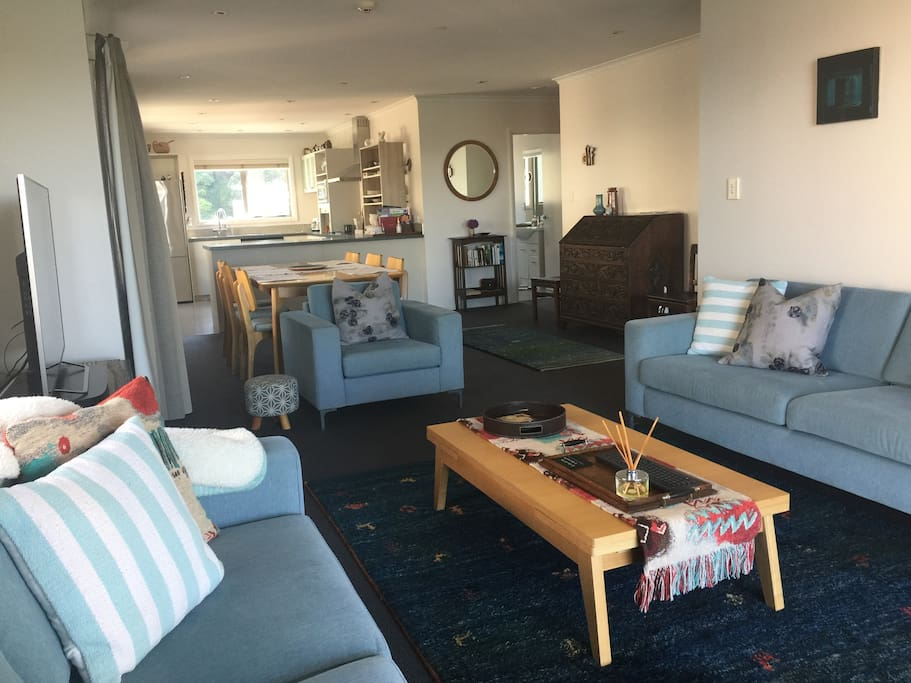 Spacious living area with smart tv and Sonos sound system. Lots of seating options.