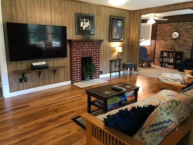 """Living Room: Enjoy the 65"""" HD TV with Cable, Netflix, and Hulu."""