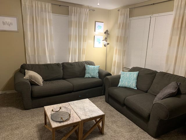 Cozy living room where you can relax after a day of exploring downtown Bentonville (which is just a short walk from the Airbnb).