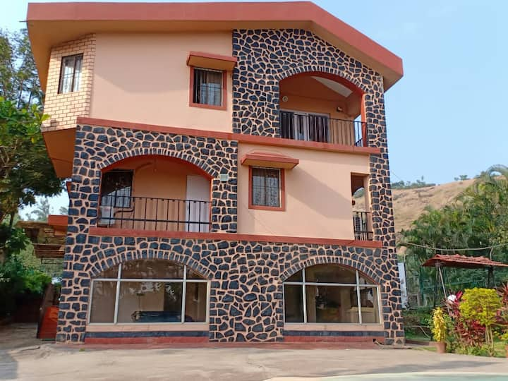 Private room in  6 BHK Bungalow with pool