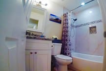 Second bathroom with shower/tub combo and detachable shower head