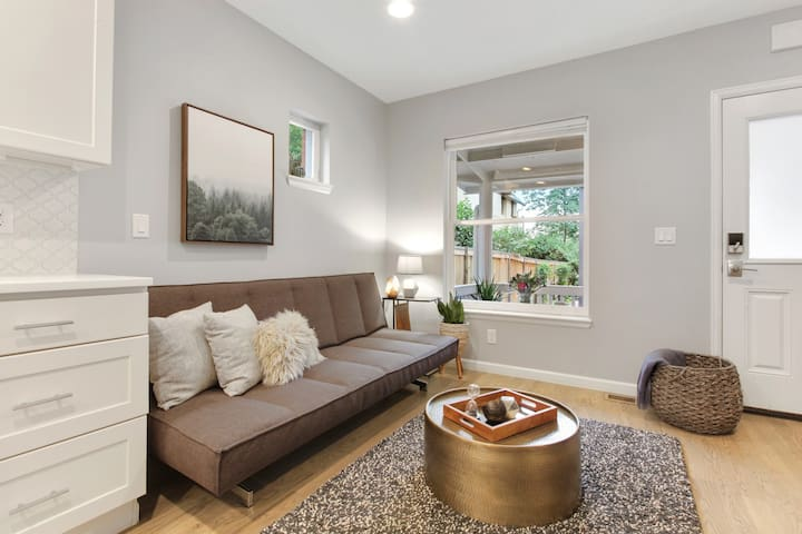 Charming picture window in the living room opens onto the adorable front porch.