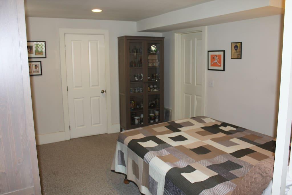Front Bedroom. Door on left is to Back Bedroom and door on right is to Bathroom/Kitchen area.