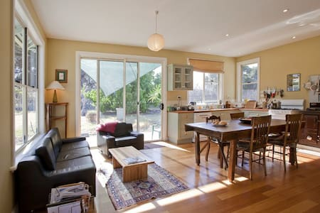 Large sunny country farm house set in open gardens