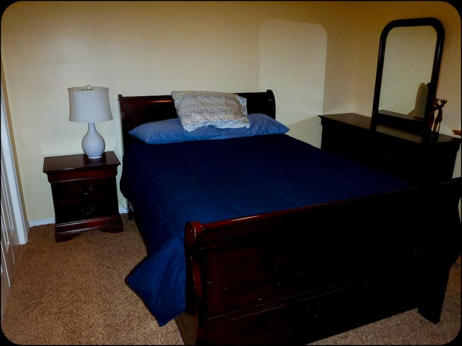 First bedroom with full pillow top mattress