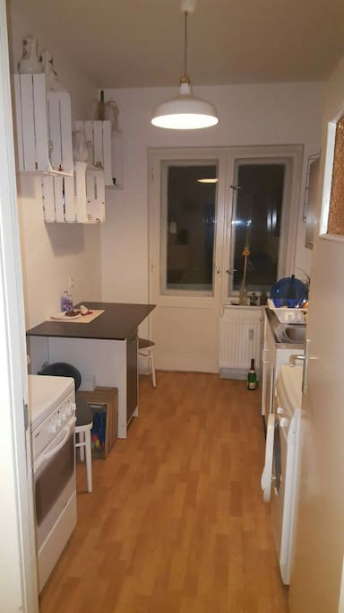 Kitchen with table on a very weird height
