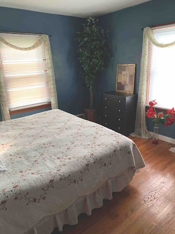 King size bedroom with hardwood floors