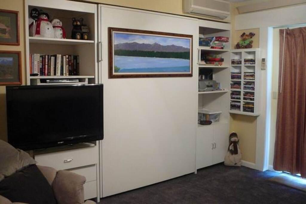 Studio Living Room with Queen Sized Murphy Bed