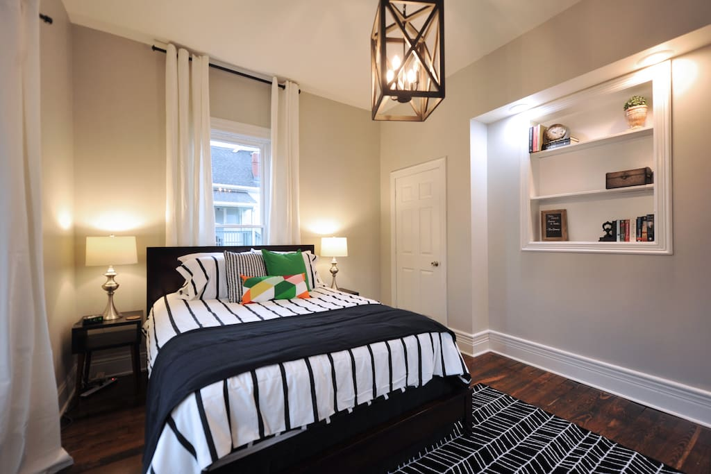 Master bedroom with wonderful natural light. Comfortable queen bed and spacious closet!