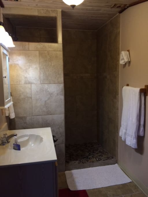 Nice walk in shower with tall removable shower head