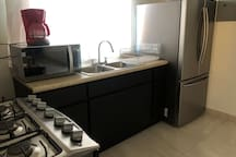 It has a small kitchen but it won't disappoint you, the fridge is cold, the coffee maker new, and the stove is hot! And if you have a meal you would like to reheat, we got the microwave