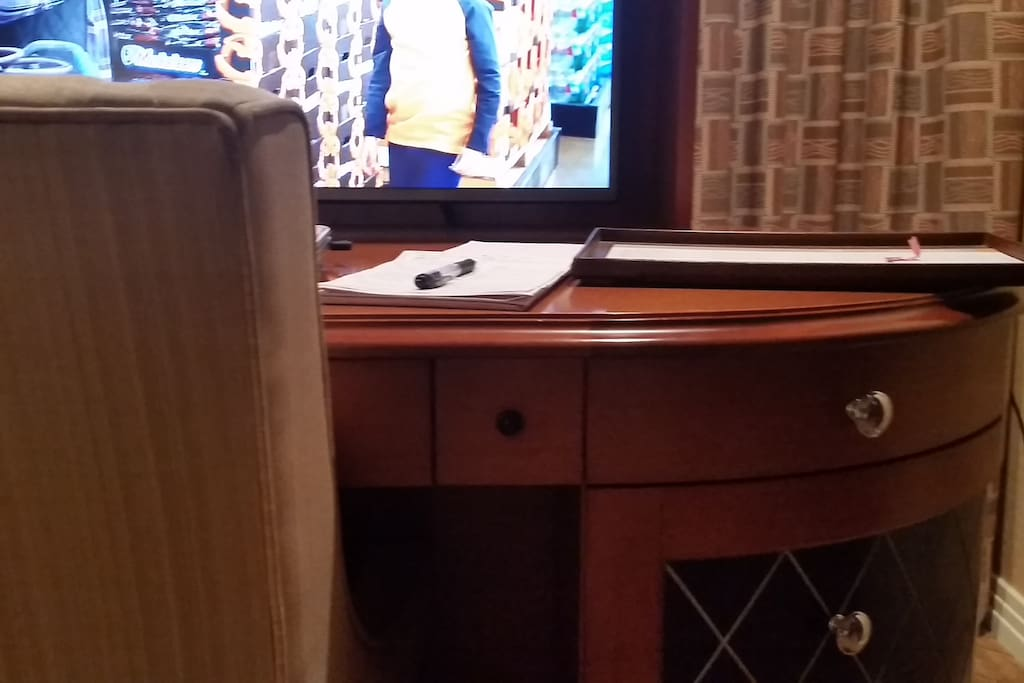 TV rises up from desk in Master Bedroom