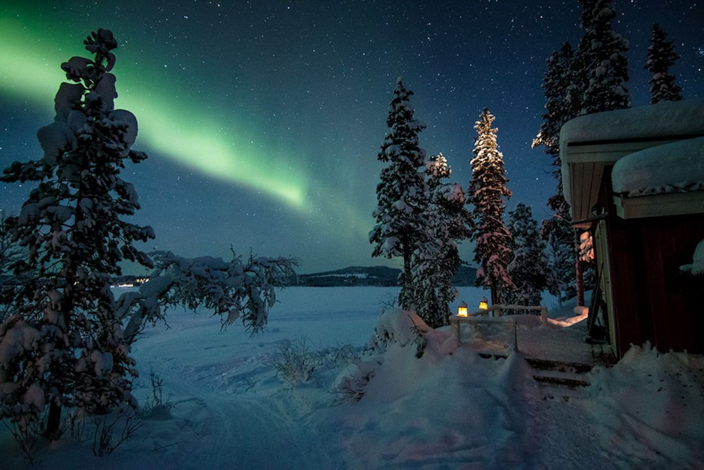 Arctic Light Suite during winter overlooking the frozen Torne River