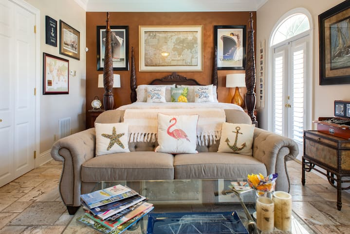 King Size Poster Bed with French doors over looking the pool