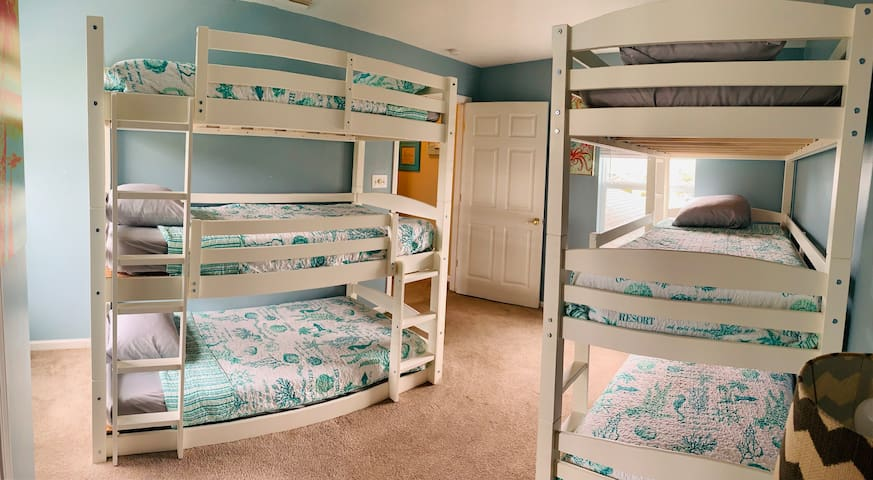 Two sets of triple bunks make this a great kids hideaway!