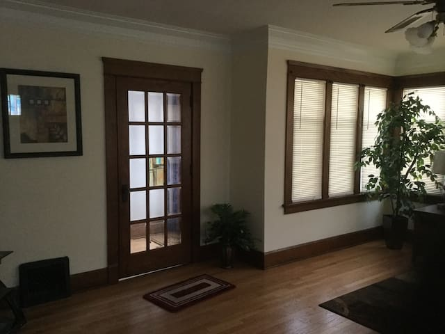 Beautiful beveled glass in antique wood French doors