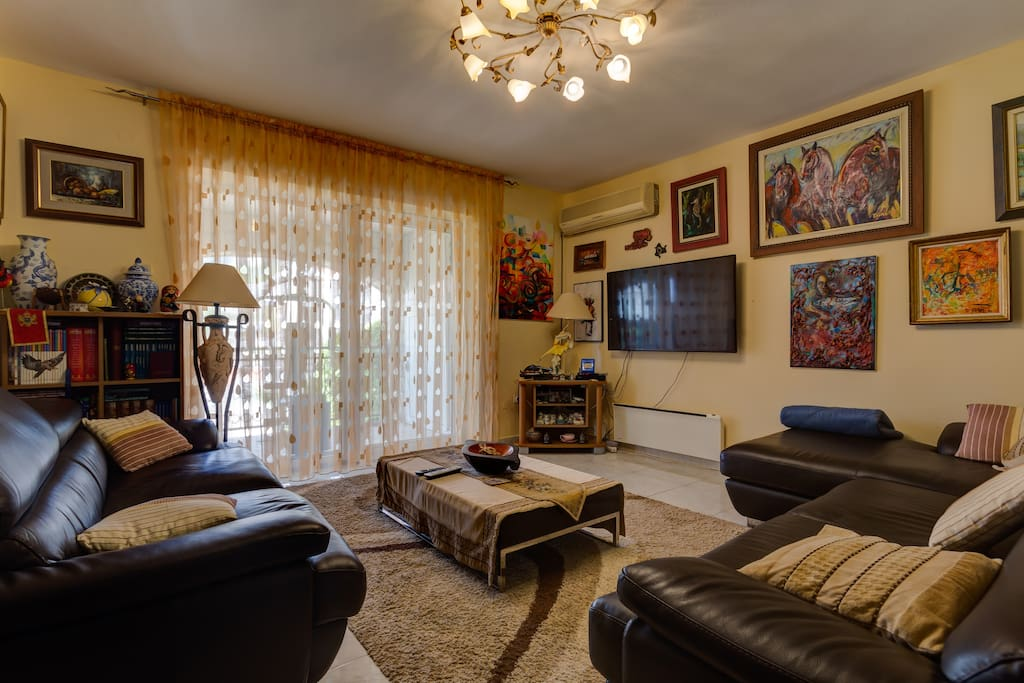 A living room where you can spend your time. It has a flat TV, two couches that will provide you with comfort.