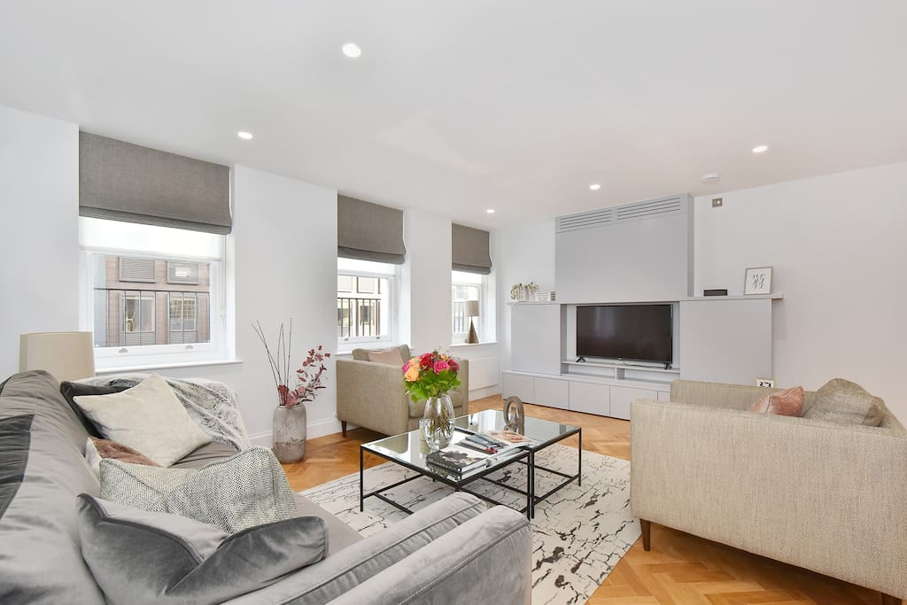 The spacious, open plan living area with Lounge, Dining Area and Kitchen