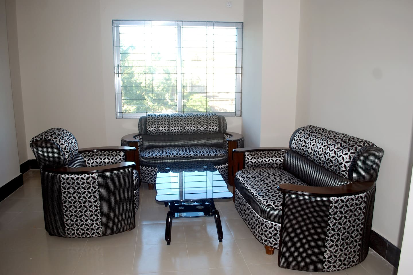 Stylish 3 piece sofa & glass table with mosquito protection on all windows.