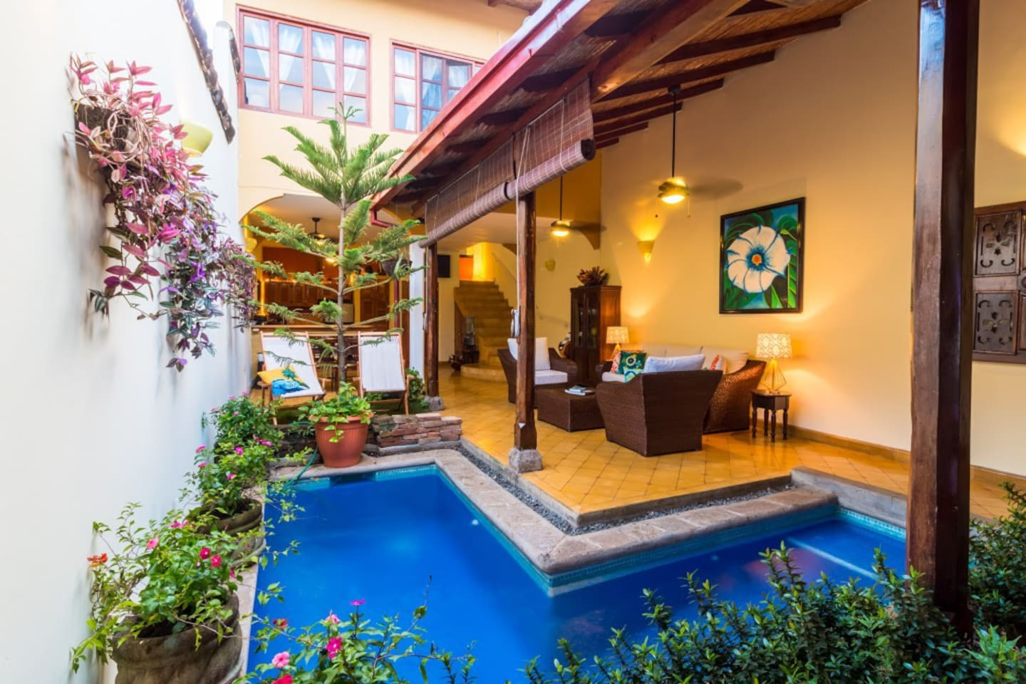 On the best street in town, Casa Romantica surprises you when you come inside! The private pool is both indoor and outdoor, so guests can take a dip in sun or shade, stargaze at night or float in a rain storm, all from the living room!