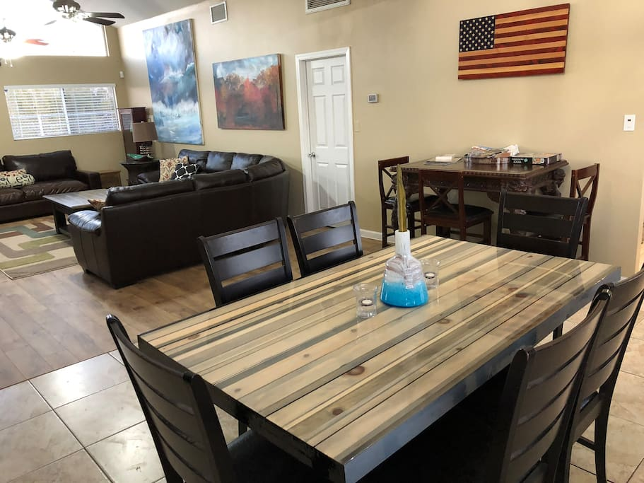 Dinning Room with Hand crafted Table plus extra Table/Buffet Puzzle table. Open Concept Living/Dinning rooms