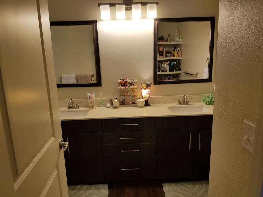 Attached master bath with dual vanity and spacious walk in shower.