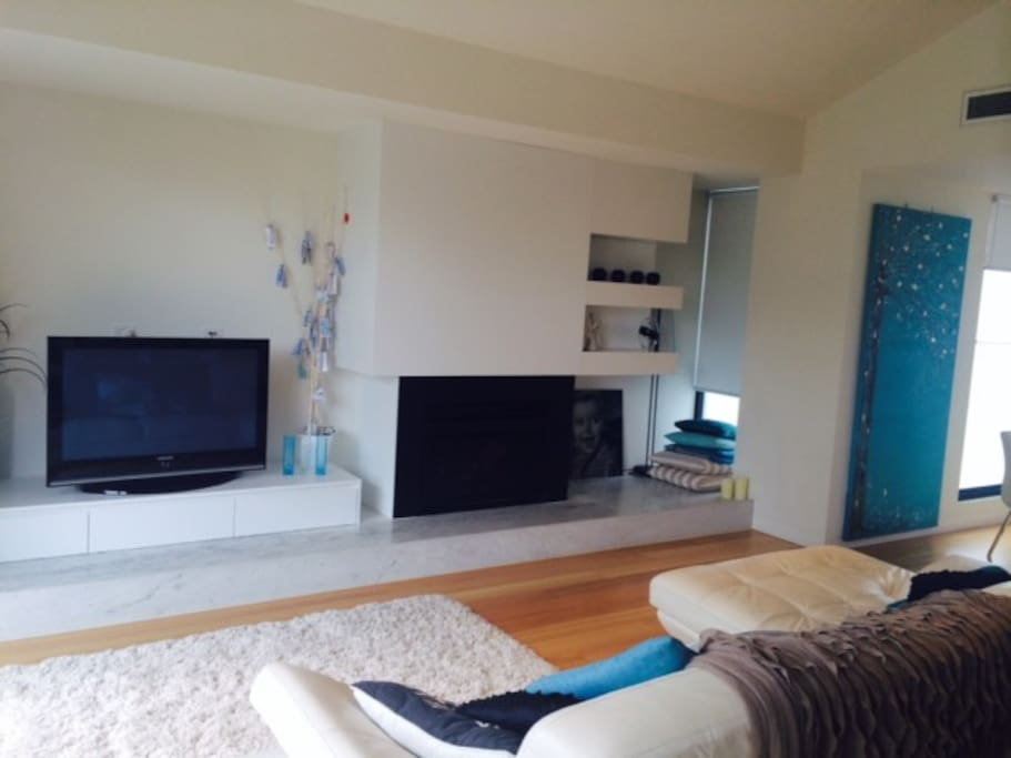 Lounge area with plasma TV, DVD and open fire