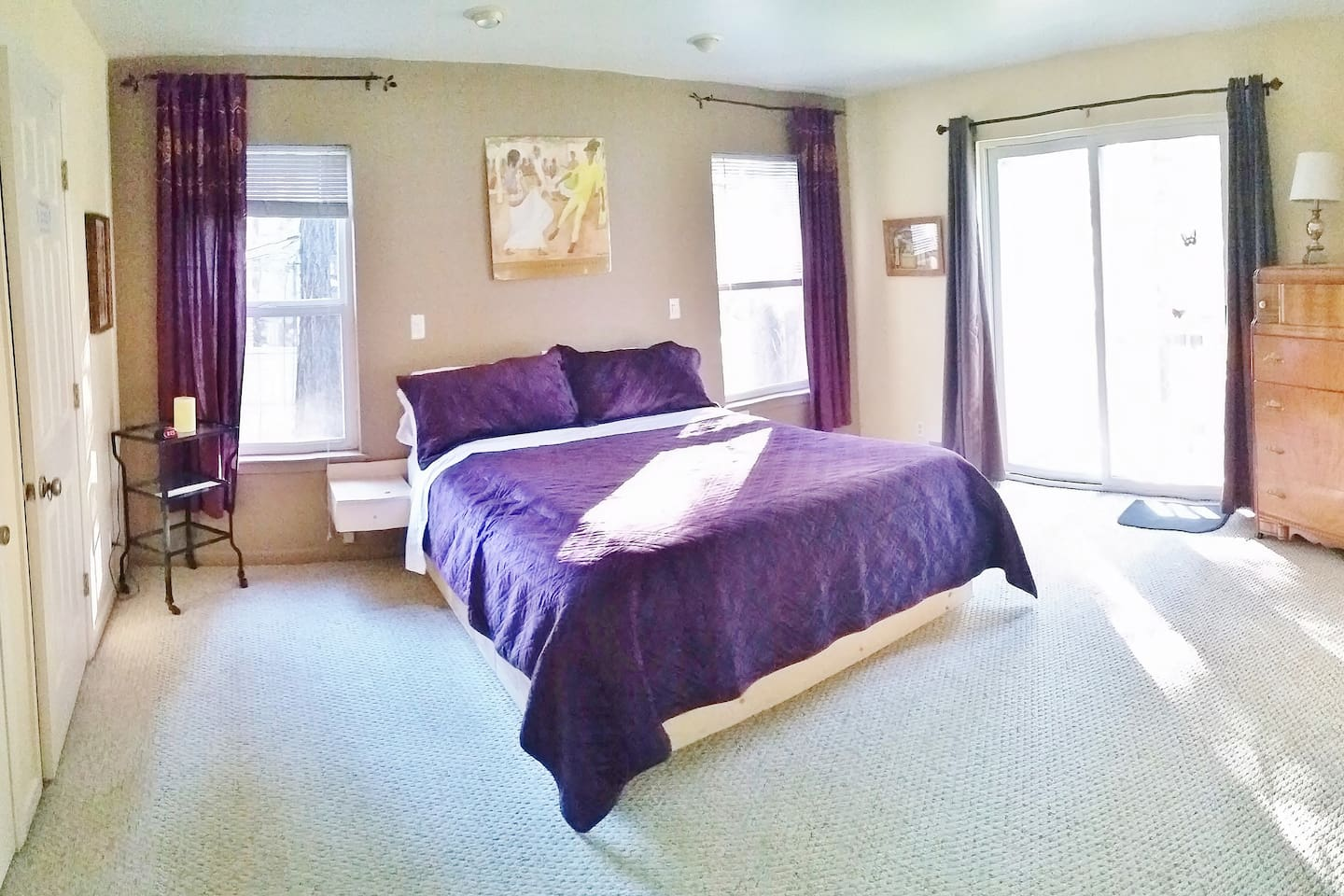Master bedroom, Cal King size bed and balcony.