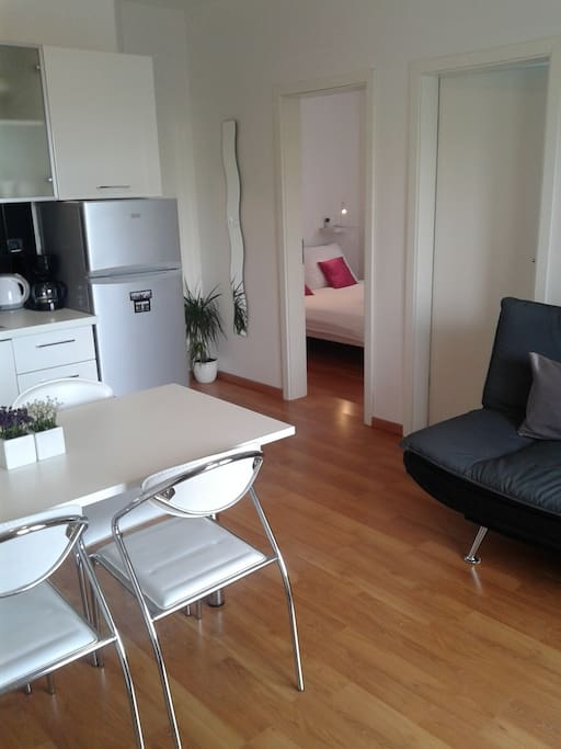 Kitchen, dining area and sofa