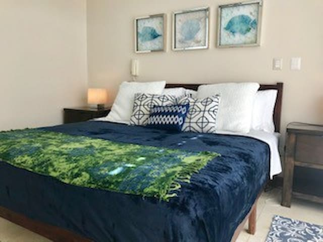 Cozy master bedroom with a large king bed. The master bedroom has an air conditioner and private full bathroom