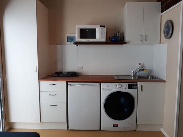 Kitchen includes 2 hotplates, microwave, kettle, toaster and fridge.  Everything you need to prepare and cook meals plus a washer/dryer combo