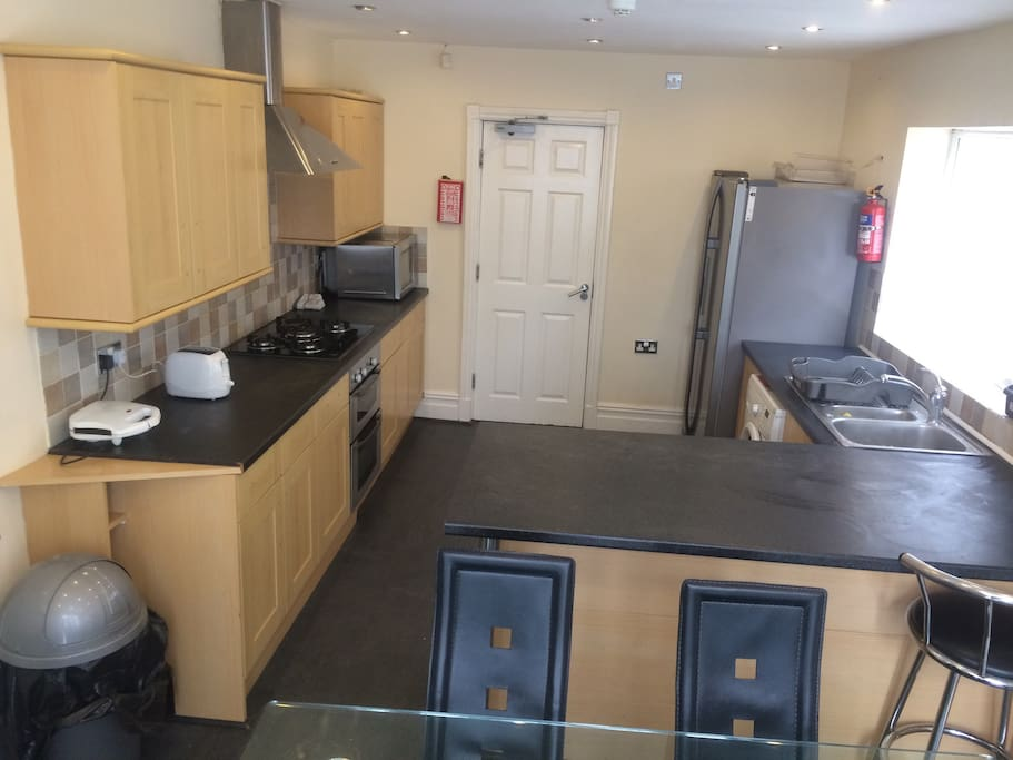 Kitchen with all modern appliances & 6 seater dining table