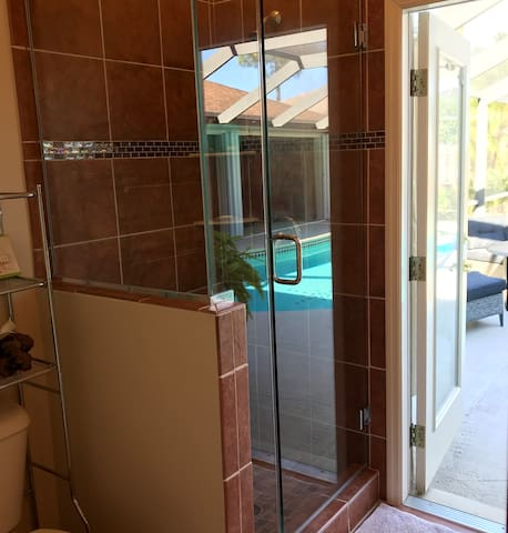 Turtle Rooms bathroom has large walk in shower with direct access to pool