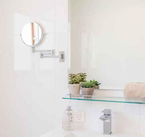 Bathroom contains shower, bath and toilet - additional separate toilet off laundry area
