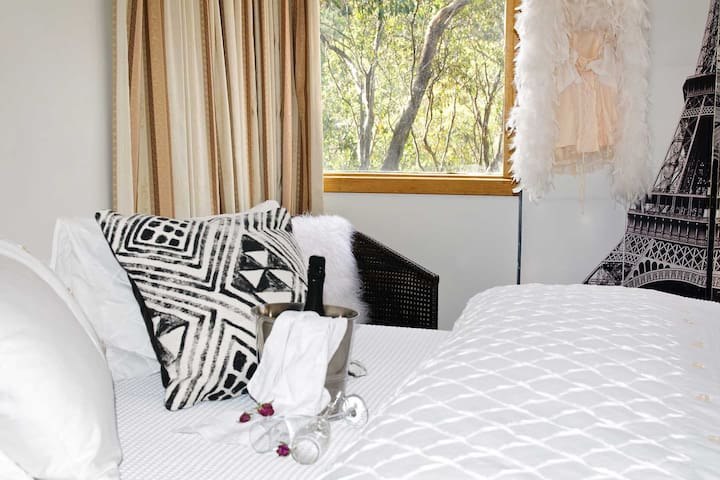 Views of the gum trees in your French inspired bedroom with Queen size bed.