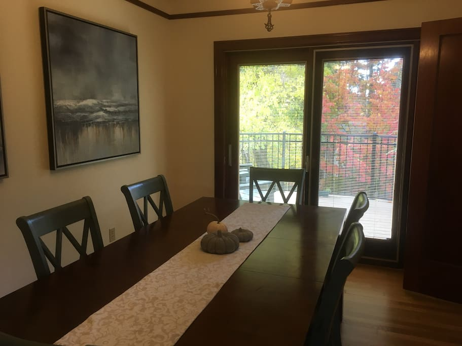 Formal dining room has a beautiful view of the backyard where you can watch the changing of the colors.leads to the deck off of the living room.  Table seats 8.
