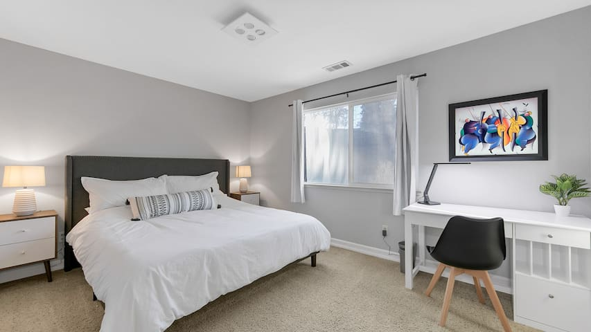 Fourth Bedroom with King Bed and working/study nook. Bright and spacious with large walk-in closet.
