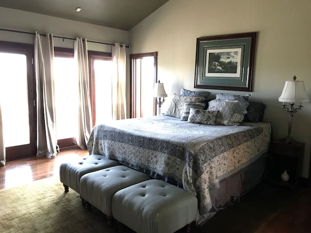 """Master Bedroom - king size bed and 45"""" TV."""