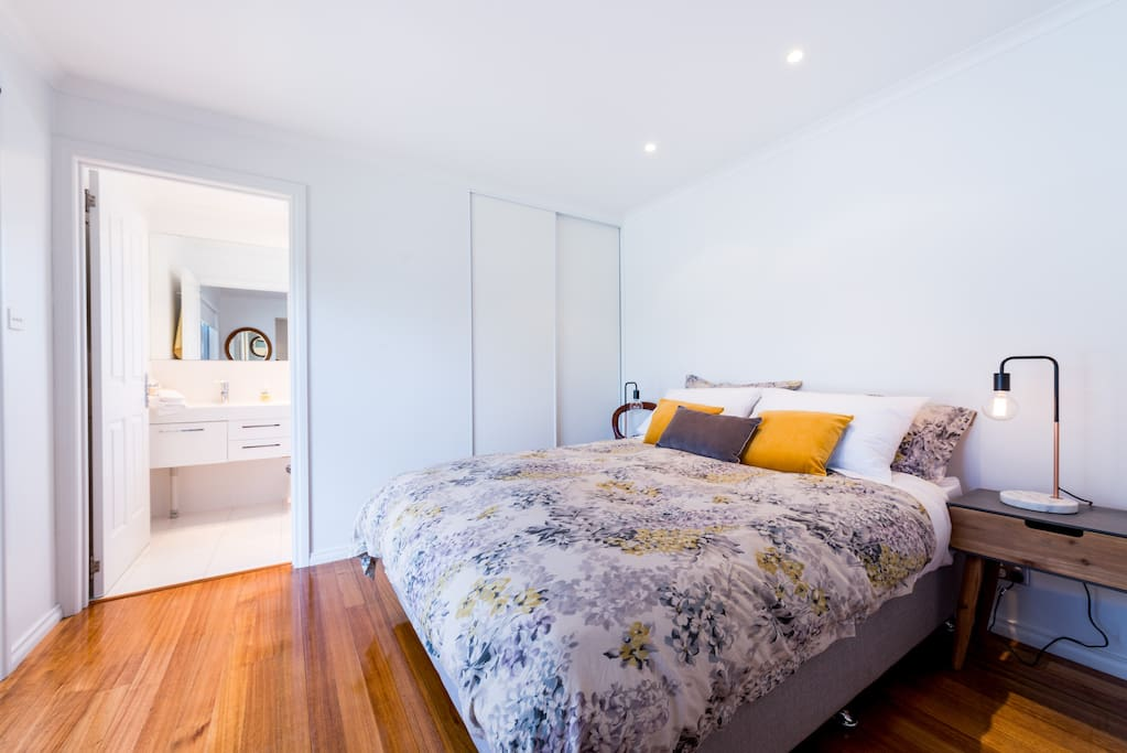 Bedroom featuring queen size bed and built in wardrobe